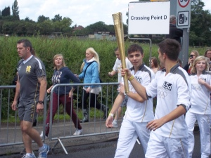 The Wanted carrying the Olympic torch